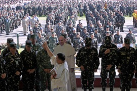 Officers of the Armed Forces of the Philippines prepare for this week's papal visit [Reuters]