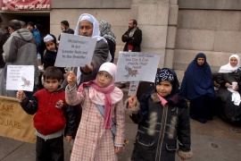 Children hold placards denouncing the publication of cartoons of the Prophet Muhammad in 2006 in London [EPA]
