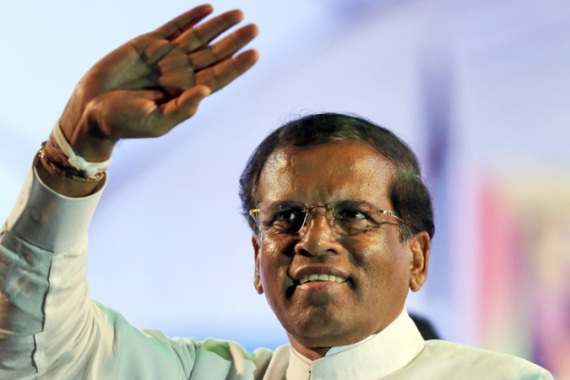 Maithripala Sirisena defected to run against former political ally Mahinda Rajapaksa [EPA]