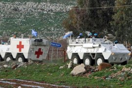 UN peacekeepers in armoured vehicles patrolled the Lebanese-Israeli border in southern villages after rocket attacks [AP]
