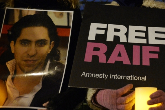 Badawi was sentenced to 10 years in jail for blogging about free speech and 'insulting Islam' [File: Facundo Arrizabalaga/DPA]