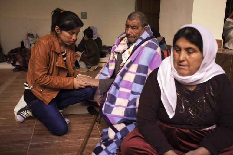Gulistan reassures her father, Hero Qasm, 65, and her mother, Meyadad Nechman, 36. She believed her parents were dead until she saw them on a TV news report about the hostages who were released.