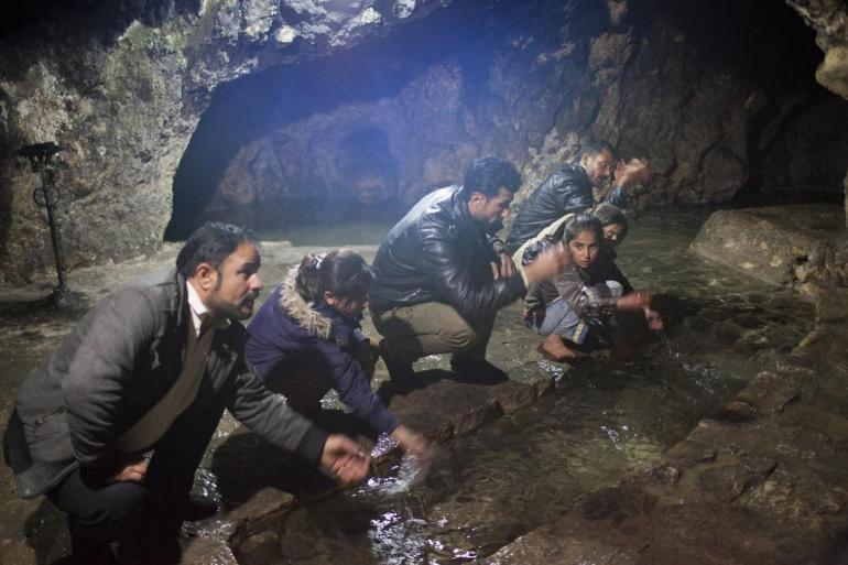 Yazidis visit a spring of holy water inside the temple in Lalish in northern Iraq. Yazidis who were taken by ISIL come to be cleansed in the sacred water.