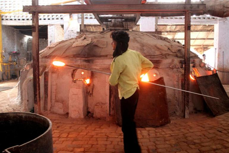 The glass is melted in primitive furnace where temperature is around 1500 degrees.