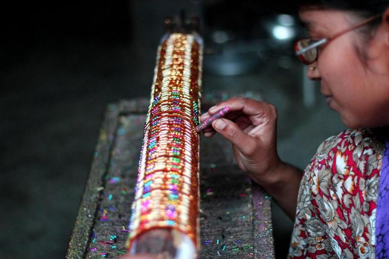 Uma Devi, 25 working on a set of bangles with precision. All the women in the township, in addition to this work, also take care of their household.