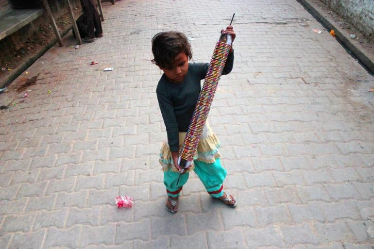 5 year old girl carrying a set of crafted bangles from her home to a nearby shop.