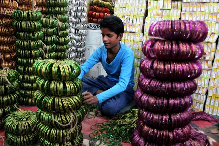 Salim, 14 assembling and packing bangles before they are ready to be supplied to the market vendors.