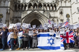 File: People hold Israeli and Union flags outside the Royal Courts of Justice as Jewish groups rally in London [Justin Tallis/Getty Images]