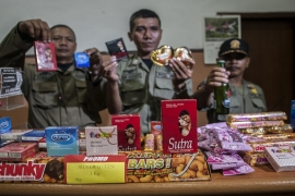 Indonesian police confiscated Valentine's Day promotions of condoms, chocolates, and beer [Getty Images]