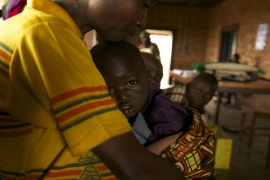 A mother with her baby at a feeding centre in impoverished Burundi [Hannah McNeish/Al Jazeera]