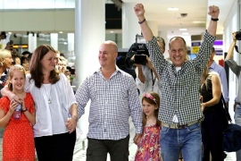 Greste called for the release of two colleagues still in custody after he arrived in Brisbane [Reuters]