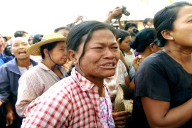 Villagers shout slogans during a protest against forced evictions and violence by security forces at a mine in northern Myanmar [AP]