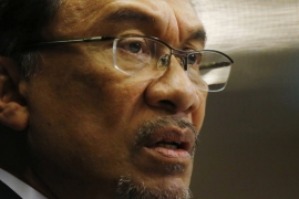Anwar has been in politics since emerging as a fiery student activist in the 1970s [File: Olivia Harris/Reuters]