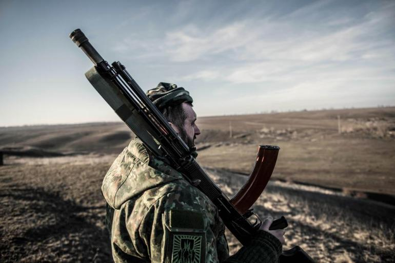 From a military base in the village of Berdianskwe, a fighter with the Azov battalion looks out towards the front line village of Shyrokine, the scene of heavy fighting in recent weeks.