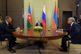 The presidents of Armenia and Azerbaijan meet face to face during talks hosted by Russia [Reuters]