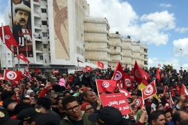 Thousands took to the streets of Tunis for Sunday's anti-terrorism march [AFP]