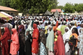 People from an internally displaced persons camp in Maiduguri register to vote [AFP]