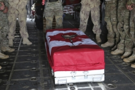 Pallbearers from the Canadian Special Operations Regiment pay their respects over the casket of Sgt. Andrew Joseph Doiron [REUTERS]