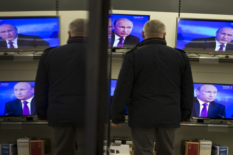 The Kremlin has gained increasing control over Russian media outlets in recent years [Alexander Zemlianichenko/AP]