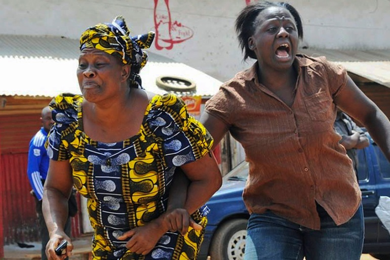 Women run from the scene of a Catholic Church bombing in Jos in March 2012 [Reuters]