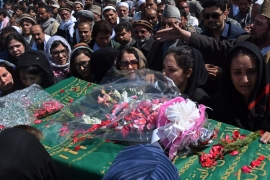 Family of Afghan woman lynched by mob demands justice