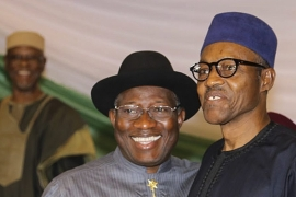 On March 26, Jonathan (L) and Buhari (R) signed a peace deal, promising to recognise official results of the poll [EPA]