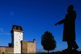 Narva fortress from the 13th century, with the statue of Vladimir Lenin in the foreground [Getty]