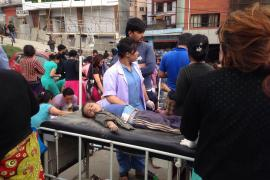 An injured child receives treatment outside Medicare Hospital in the capital, Kathmandu.