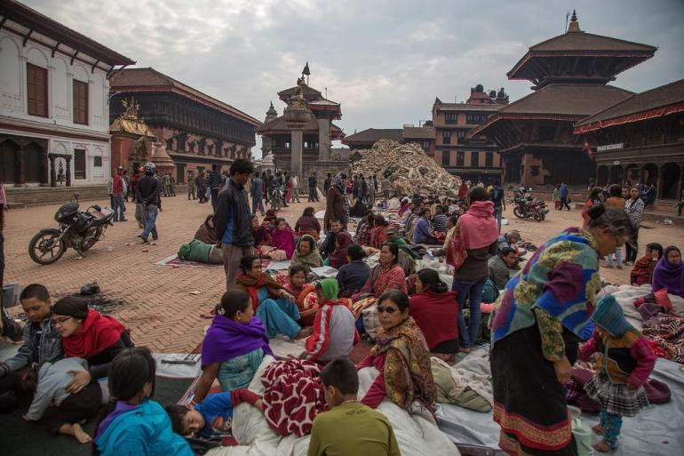 Residents sit in Bhaktapur Durbar square in Bhaktapur, Nepal. The 7.8 earthquake hit Kathmandu mid-day on Saturday.