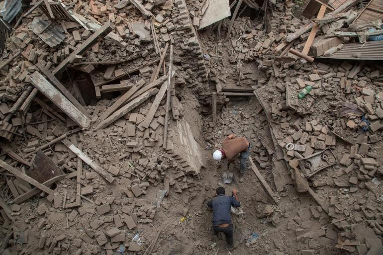 Many houses, buildings, and temples in the capital were destroyed during the earthquake, leaving thousands dead or trapped under the debris as emergency rescue workers attempt to clear debris and find survivors.