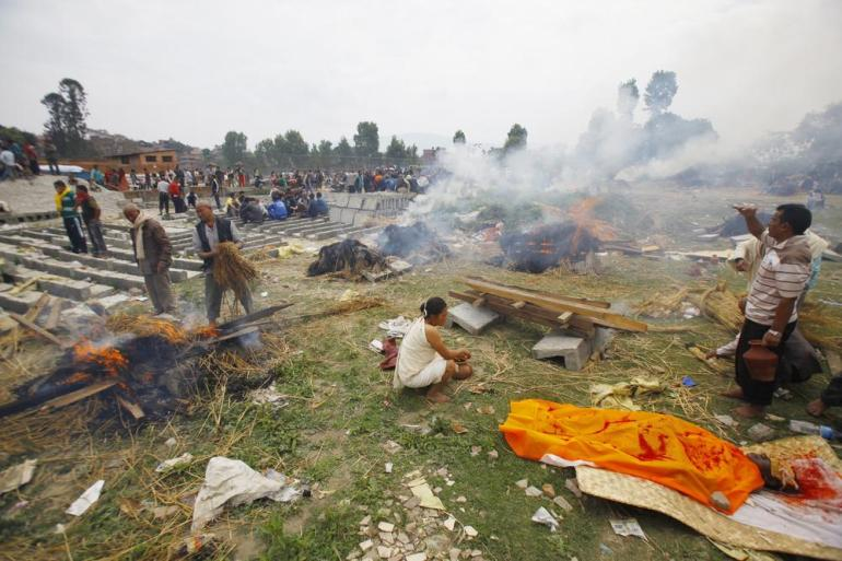 Nepalese people gather to cremate family members who fell victim to Saturday's earthquake.