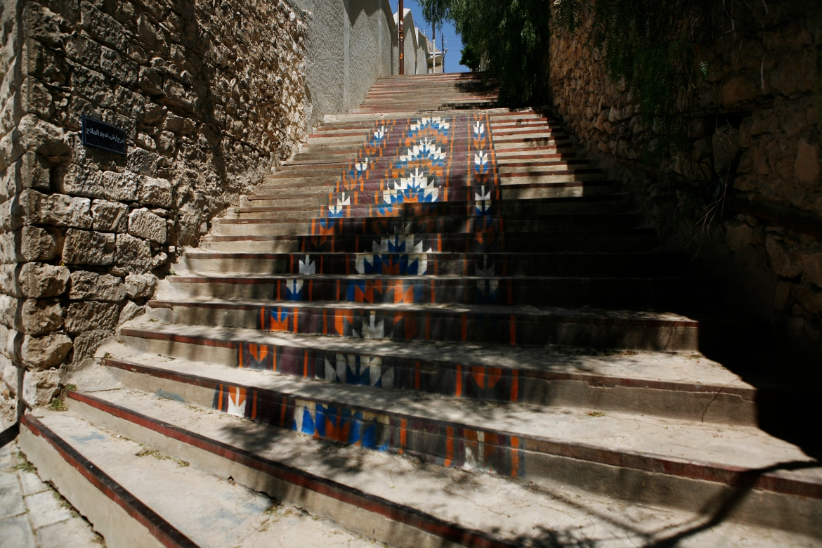 The stairs leading to Darat al-Fanun, a leading contemporary art museum, are painted with a traditional Jordanian embroidery pattern. [Silvia Boarini/Al Jazeera]