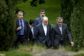 Head of Iranian Atomic Energy Organization Ali Akbar Salehi talks with Hossein Fereydoon, special assistant to the Iranian president [AP]