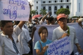 Myanmar activists march to commemorate the anniversary of a crackdown on protesters occupying Letpadaung copper mine [AP]