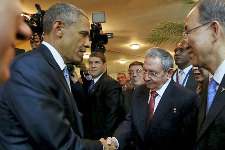 Barack Obama and his Cuban counterpart Raul Castro shake hands as UN Secretary General Ban Ki-moon looks on [Reuters]