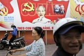 Communist Party banner bearing portrait of Vietnamese national hero Ho Chi Minh and other communist leaders in Ho Chi Minh City [AP]
