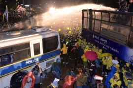 About 13,000 police and 470 police buses were deployed in the area around Seoul's main ceremonial thoroughfare [AP]