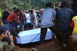 A coffin with the body of Indonesian drug convict Zainal Abidin is buried after he was shot dead by firing squad in April [AFP]