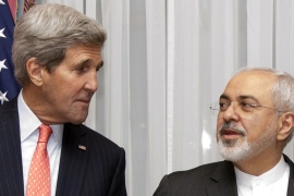 US Secretary of State John Kerry listens to Iran's Foreign Minister Mohammad Javad Zarif [AP]