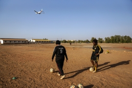 Sudan's unofficial women's national football team trains three times a week on a dusty, uneven pitch in an open park near Khartoum's international airport. [Fatma Naib/Al Jazeera]