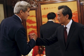 During Kerry's visit to Beijing, FM Wang stressed the determination of China to safeguard its sovereignty [Reuters]