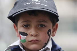 A Palestinian boy takes part in a rally ahead of Nakba Day, in the West Bank city of Ramallah [REUTERS]
