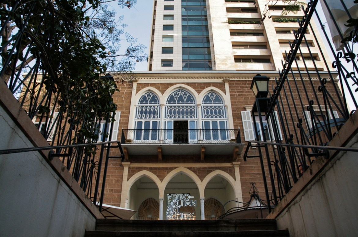 Although situated in Ashrafieh's enormous Abdallah Bustros Palace, the Metropolitan Art Society is dwarfed by a nearby block of modern flats. The contemporary art gallery, which opened in 2013, features the distinctive three-arch exterior typical of 19th century Ottoman houses. [Venetia Rainey/Al Jazeera]