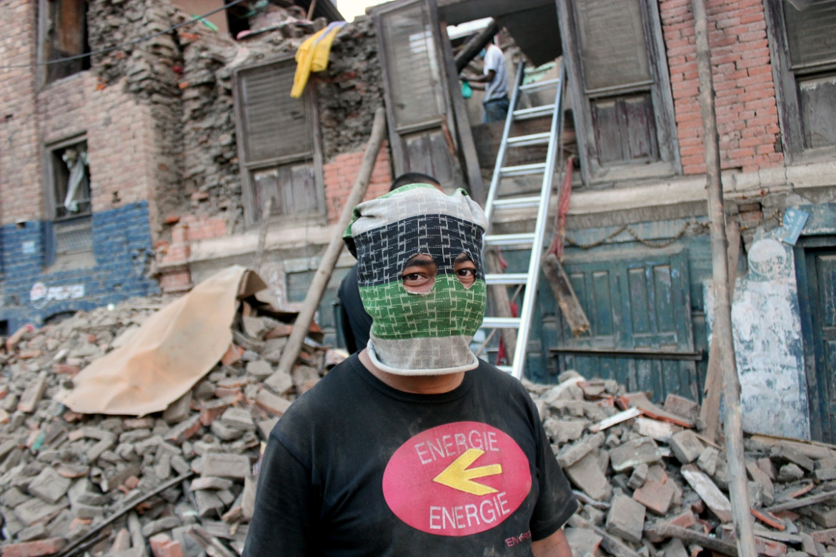 Pun Thapa Magar 38, town of Balaju:  'People call me Spiderman these days, as I help others affected by the earthquake by going inside houses that are cracked or damaged and people are scared to enter such houses. My own house was destroyed in this disaster. But the only thing that keeps me strong is the presence of my family that is safe, thankfully. I know many who have lost their loved ones.' [Showkat Shafi/Al Jazeera]