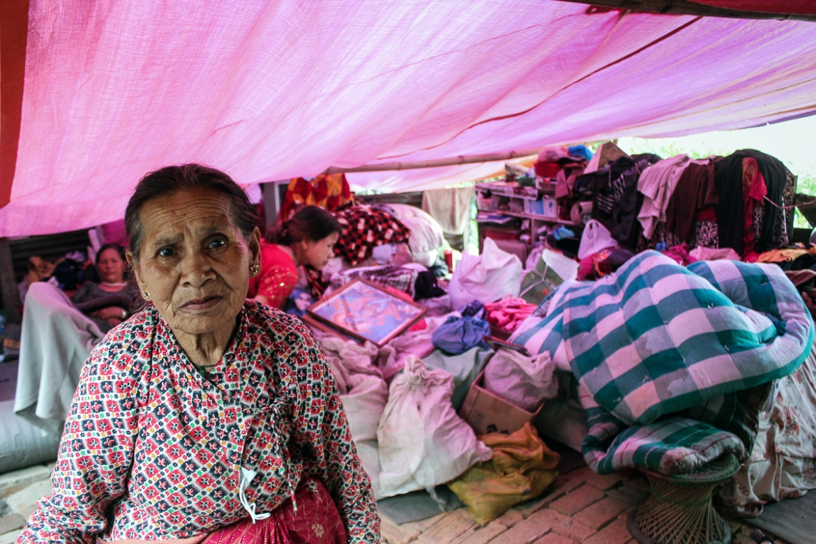 Kachi Karmachari, 83, town of Balaju: 'Life in a rescue camp is tough. We are four families sharing one tent, for the past 10 days. I have forgotten what privacy is all about. There are six women in this tent and I am the oldest one. I don't sleep during the night, as I have to take care of my belongings and also my family members. I just hope that all this ends one day and I will wake up from a very bad dream.' [Showkat Shafi/Al Jazeera]