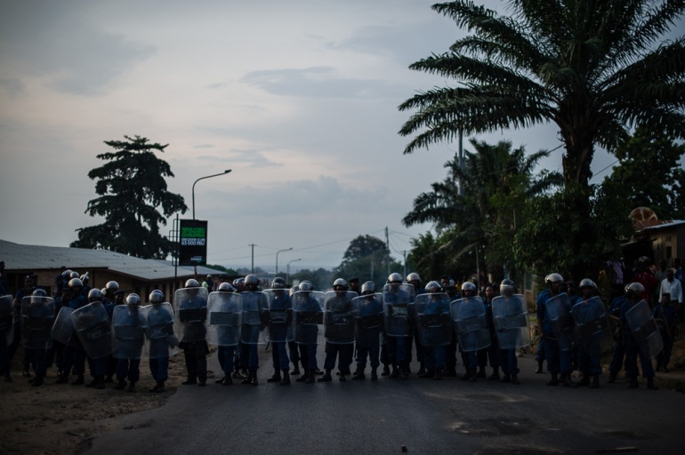Police officers line up against protesters in the Musaga neighbourhood of Bujumbura. The police have prevented protesters from reaching the city centre. [Phil Moore/Al Jazeera]