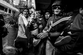 Protesters carry the body of student Bassil Da Costa after he was shot in the head during a protest in Caracas [Alejandro Cegarra]
