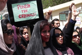 Afghan women chant slogans during a protest demanding justice for a woman who was beaten to death by a mob [Getty]