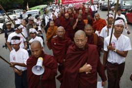 About 400 people, including 40 monks, gathered to show their support for the anti-Rohingya campaign [EPA]