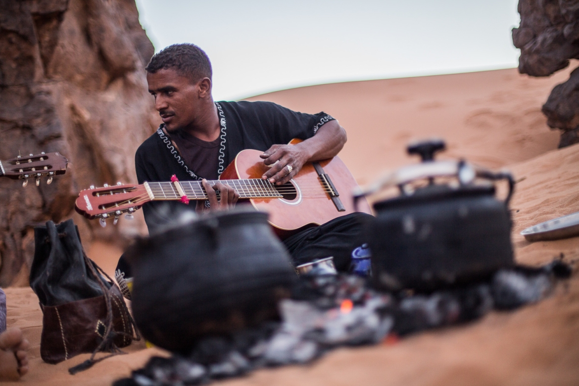 A man plays traditional Tuareg music, which comprises an important part of the Tuareg culture. [Mauricio Morales/Al Jazeera]
